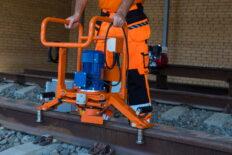 Rail head grinding machine